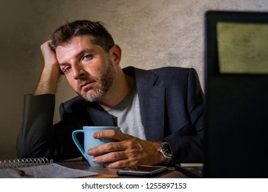 young attractive depressed and frustrated man working at office computer desk desperate and overwhelmed feeling upset suffering depression and anxiety crisis in financial business problem