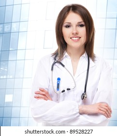 Young attractive doctor isolated over modern building