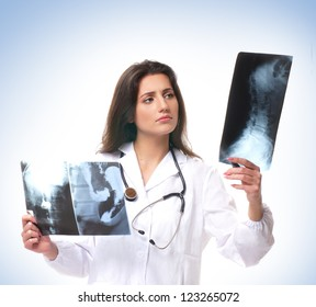 Young attractive doctor over the blue background
