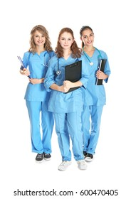 Young attractive doctors on white background