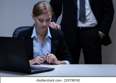 Young attractive employee and problem with her boss