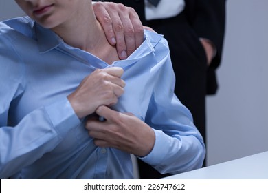 Young attractive employee and problem with her boss at work