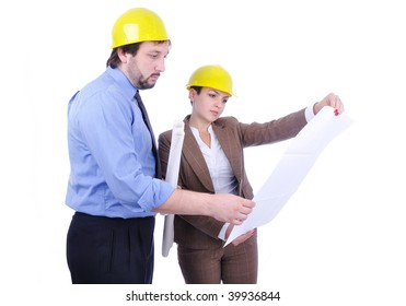 Young attractive engineers with blueprints