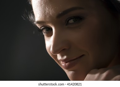 Young attractive european brunette portrait: windy closeup