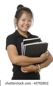 Young attractive female Asian student studying