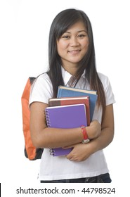 Young attractive female Asian student holding school books