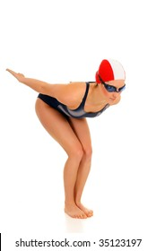 Young attractive female athlete, swimmer with goggles and swimming cap.  Studio shot.