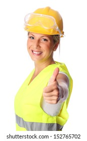 Young attractive female construction worker wearing a reflective vest and hard hat. White background.