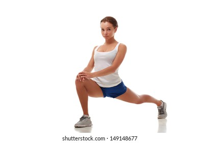 Young attractive female fitness model stretching legs, entire body, full