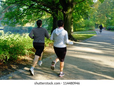 Young attractive female joggers