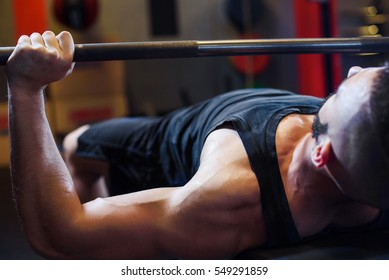 Young attractive fit Man with beard In Gym Exercising Chest On The Bench Press. Bodybuilding, motivation, active, healthy lifestyle