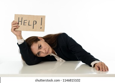 Young attractive frustrated and tired latin businesswoman holding help sign message exhausted, sad under pressure and stress isolated on white in unemployment depression overwork concept