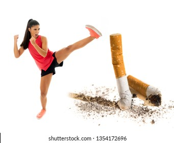 Young attractive and furious latin sport woman in fight kick attacking angry against cigarette butt in stop and anti smoking advertising campaign concept and healthy lifestyle, you can do it concept.