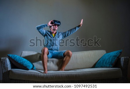 c6e20972780 young attractive gamer man using VR goggles headgear technology playing  simulator 3D video game having fun