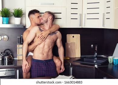 Young attractive gay couple in the kitchen.