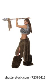 Young attractive girl in costume of savage woman attack by a spear