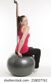 young attractive girl  exercises with gymnastic ball