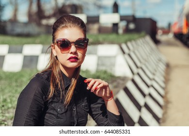 Young attractive girl in fashion sun glasses