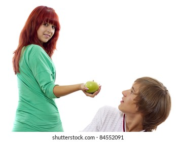 Young attractive girl gives a green apple to her boy
