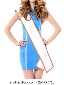 Young attractive girl in mini skirt wearing beauty contest sash.No Face, blank space for text.