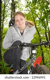 The young attractive girl on a bike