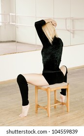 Young attractive girl practicing in aerobics room