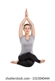 Young attractive girl practicing yoga isolated on white background