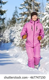 Young attractive girl running on cold winter day