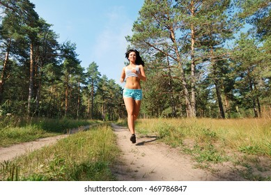 Young attractive girl running on the morning