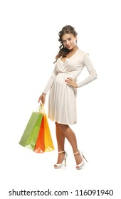 Young attractive girl with the shopping bag isolated on white