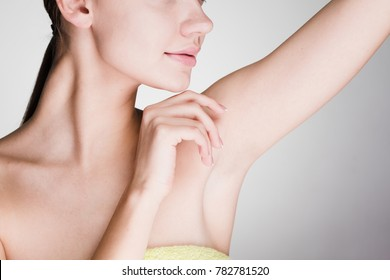 young attractive girl showing her armpits without hair