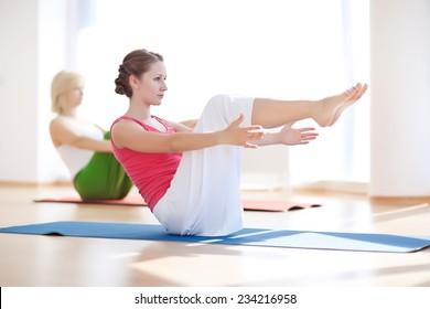 Young attractive girls do yoga. Seriya