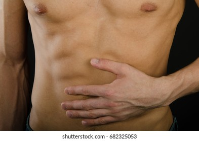 Young attractive guy. Situations. Gestures and poses. Abdominal pain.