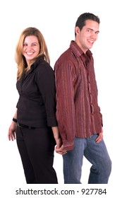 A Young Attractive Happy Couple Holding Hands (Isolated)