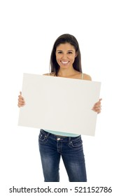 young attractive and happy hispanic woman holding blank billboard with copy space isolated on white background in advertising concept