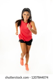Young attractive happy latin woman in sport clothes with beautiful smile running and training on jogging workout isolated on white background in fitness healthy lifestyle concept.