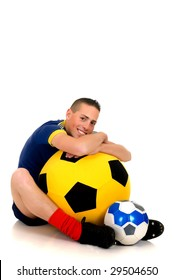 Young attractive happy soccer player with football on white background, studio shot