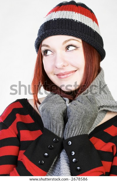 Young attractive in knit hat smiles.