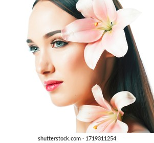 young attractive lady close up with hands on face isolated flower lily brunette spa nude makeup macro