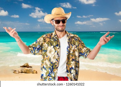 a young, attractive male in a colorful outfit in a tropical island setting as a stereotype tourist