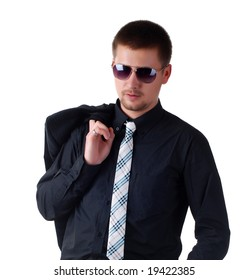 young attractive man in a black suit and sun glasses