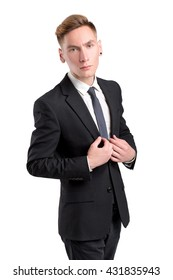 young attractive man in a black suit and white shirt posing in Studio. isolated on white background