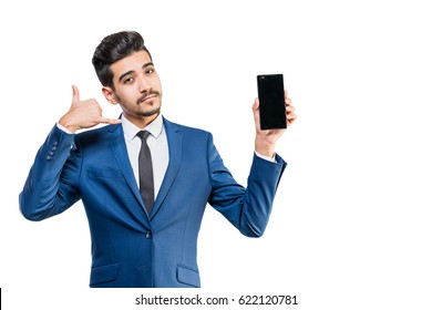 Young attractive man in a blue suit with the phone shows a hand gesture call me
