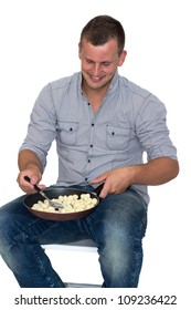 Young Attractive Man Cooking gnocchi in A Pan
