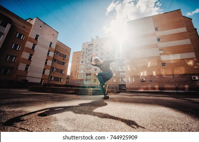 Young attractive man dancing in urban background. the dancer dances on the street. with the light view dance