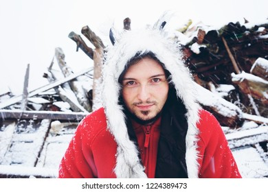 Young and attractive man enjoying a snowy winter day