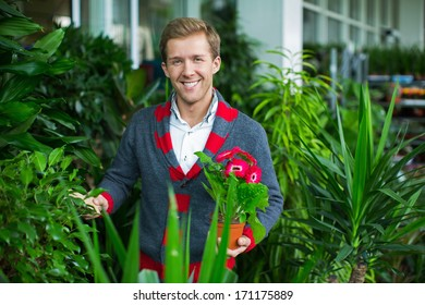 Young attractive man with a flower