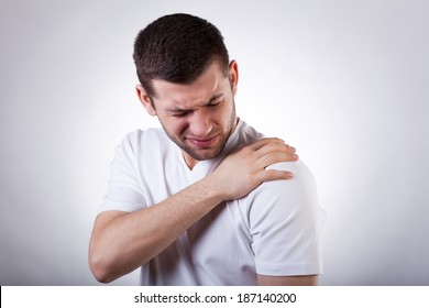 Young attractive man having shoulder pain