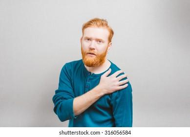 Young attractive man having shoulder pain
