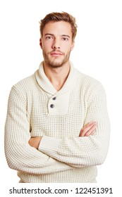 Young attractive man with his arms crossed looking seriously